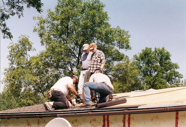 Lodge Roof gets reshingled : with lots of help from friends & neighbours