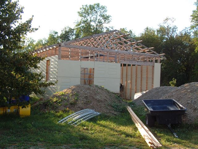 "New garage being built by lodge : 2.5 year project with ""loading doors"" from Menards, International Falls Minnesota & gravel from Miller Contracting in Morson Ontario"